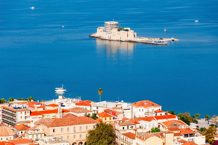 Bourtzi is a water castle located in the middle of Nafplio harbour. Nafplio is a seaport town in the Peloponnese peninsula in Greece. Reklamní fotografie - 75223656