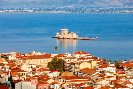 nauplio: Bourtzi is a water castle located in the middle of Nafplio harbour. Nafplio is a seaport town in the Peloponnese peninsula in Greece. Stock Photo