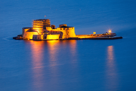 nauplio: Bourtzi water fortress in Nafplio at night. Nafplio is a seaport town in the Peloponnese peninsula in Greece. Editorial