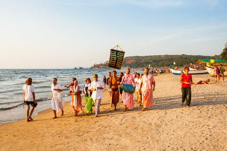 GOA, INDIA - DECEMBER 10, 2016: Krishnaites on the Arambol beach in north Goa, India before sunset.