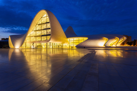 BAKU, AZERBAIJAN - SEPTEMBER 12, 2016: The Heydar Aliyev Center at night. It is a building complex in Baku in Azerbaijan, noted for its distinctive architecture and flowing, curved style.