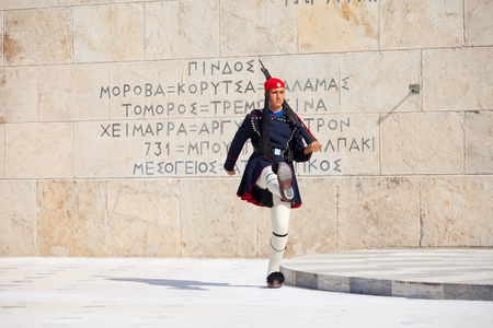 tomb of the unknown soldier: ATHENS, GREECE - OCTOBER 20, 2016: Evzone or Evzoni guarding the Tomb of the Unknown Soldier at the Hellenic Parliament building on Syntagma Square in Athens, Greece
