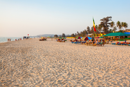 GOA, INDIA - DECEMBER 09, 2016: Beach restaurant shacks and sunbeds on Arambol beach in north Goa, India Editorial