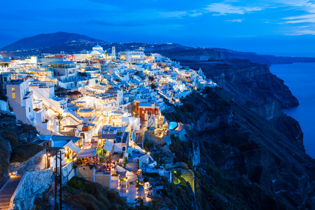 Fira town aerial panoramic view, Santorini at sunset. Fira is the modern capital of the Santorini island, Cyclades in Greece.