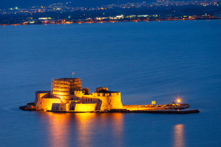 Bourtzi water fortress in Nafplio at night. Nafplio is a seaport town in the Peloponnese peninsula in Greece. Editorial