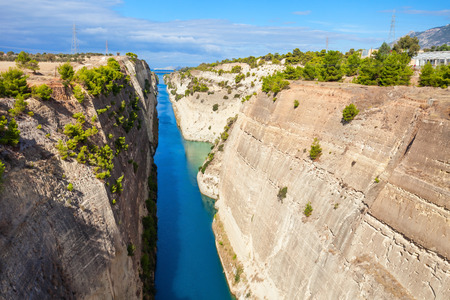 The Corinth Canal is a canal that connects the Gulf of Corinth with the Saronic Gulf in the Aegean Sea. It cuts Isthmus of Corinth and separates Peloponnese from the Greek mainland.