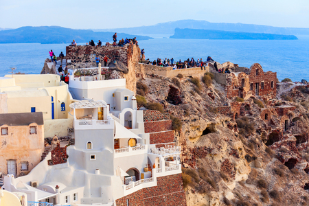 Byzantine Castle Ruins in Oia Santorini island in the Cyclades, Greece on sunset