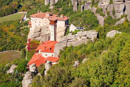 The Monastery of Rousanou or St. Barbara Monastery at Meteora. Meteora is one of the largest built complexes of Eastern Orthodox monasteries in Greece. Stock Photo