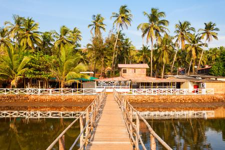 Bridge through small river on Mandrem beach in north Goa, India