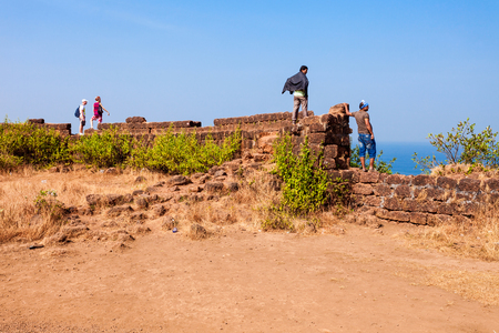 aguada: Tourists at the Chapora Fort. Fort is located in north Goa, rises high above the Chapora River, India.