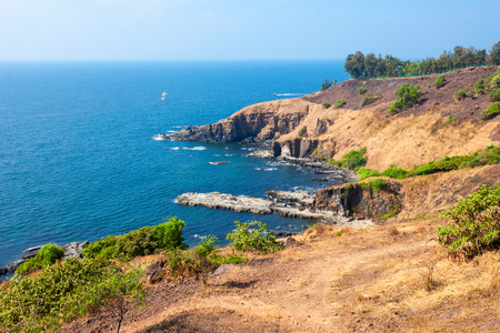 aguada: Beauty rocks on Sinquerim Beach aerial panoramic view. Its located near the Fort Aguada and its lighthouse in Goa, India.