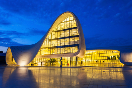 azeri: BAKU, AZERBAIJAN - SEPTEMBER 12, 2016: The Heydar Aliyev Center at night. It is a building complex in Baku in Azerbaijan, noted for its distinctive architecture and flowing, curved style.