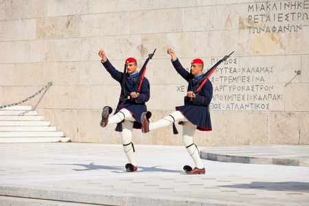 ATHENS, GREECE - OCTOBER 20, 2016: Evzone or Evzoni guarding the Tomb of the Unknown Soldier at the Hellenic Parliament building on Syntagma Square in Athens, Greece