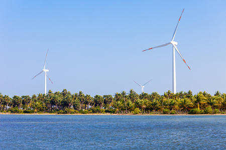 converts: Wind turbines in Kalpitiya, Sri Lanka. wind turbine is a device that converts the winds kinetic energy into electrical power. Stock Photo