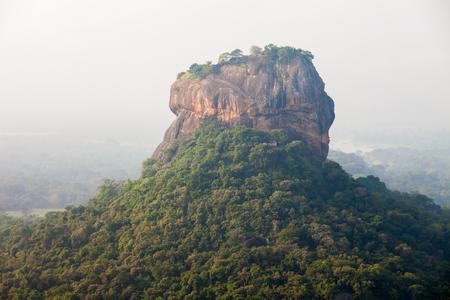 unesco world heritage site: Sigiriya Rock or Sinhagiri or Lion Rock aerial panoramic view from Pidurangala Rock near Dambulla in Sri Lanka