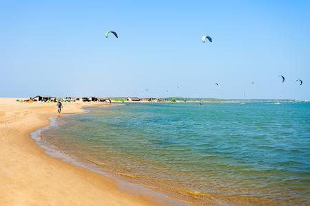 kiteboarding: KALPITIYA, SRI LANKA - FEBRUARY 09, 2017: Kitesurfers at the Kalpitiya beach in Sri Lanka. Kalpitiya is the best kitesurfing destination in Asia. Editorial