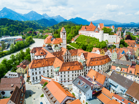 Hohes Schloss Fussen or Gothic High Castle of the Bishops and St. Mang Abbey monastery aerial panoramic view in Fussen, Germany