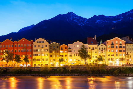 Innsbruck embankment with beauty houses at the Inn river. Innsbruck is the capital city of Tyrol in western Austria. Stock Photo