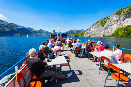 wolfgang: ST WOLFGANG, AUSTRIA - MAY 17, 2017: Boat trip on Wolfgangsee lake in Austria. Wolfgangsee is one of the best known lakes in the Salzkammergut resort region of Austria.