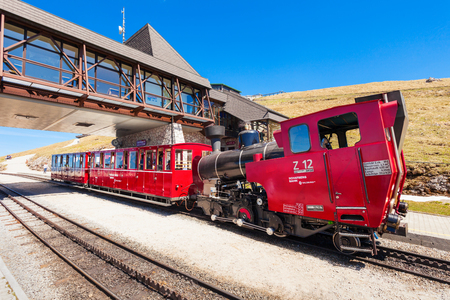 wolfgang: ST WOLFGANG, AUSTRIA - MAY 17, 2017: The Schafberg Railway train is a gauge cog railway in Upper Austria and Salzburg. Schafberg train leading from St Wolfgang im Salzkammergut to the Schafberg.