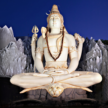 BANGALORE, INDIA - MARCH 27: Big Lord Shiva statue sitting in lotus with trident on March 27, 2012 in Bangalore, India. This Shiva Statue is highest in the world - 65 feet high.