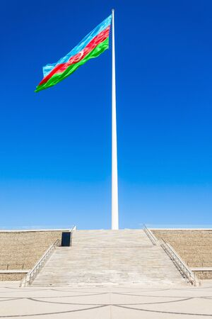azeri: National Flag Square is a large city square off Neftchiler Avenue in Baku, Azerbaijan. A flag measuring 70 by 35 metres flies on a pole 162 m high.
