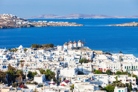The Mykonos windmills are iconic feature of the Greek island of the Mykonos. The island is one of the Cyclades islands in the Aegean Sea, Greece. Foto de archivo