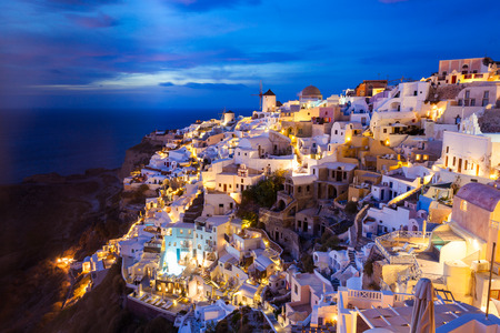 Oia on sunset. Oia or Ia is a small town in the South Aegean on the islands of Santorini in the Cyclades, Greece Stock Photo