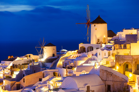 Windmills on Santorini island in the Cyclades, Greece on sunset