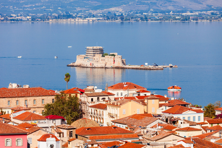 Bourtzi is a water castle located in the middle of Nafplio harbour. Nafplio is a seaport town in the Peloponnese peninsula in Greece. Stock Photo