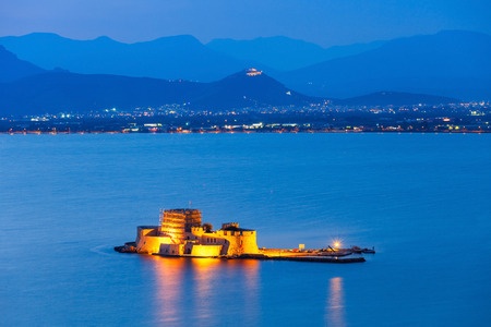 Bourtzi water fortress in Nafplio at night. Nafplio is a seaport town in the Peloponnese peninsula in Greece. Stock Photo
