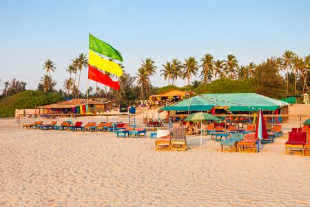 Beach restaurant shacks and sunbeds on Arambol beach in north Goa, India