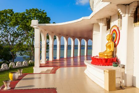 Buddha statue at the Ampara Peace Pagoda or Ampara Sama Ceitya. It is one of a number of japanese Peace Pagodas in the world. Stock Photo