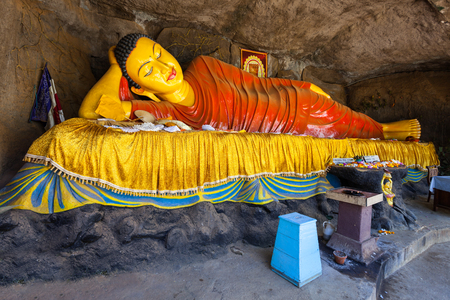 Reclining Buddha statue at the foot of Adams Peak. Adams Peak or Sri Pada is a tall and holy mountain in Sri Lanka.