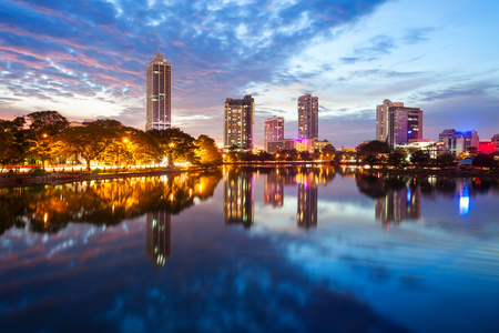 Beira lake and Colombo city skyline view at sunset. Beira lake is a lake in the center of the Colombo in Sri Lanka. Фото со стока