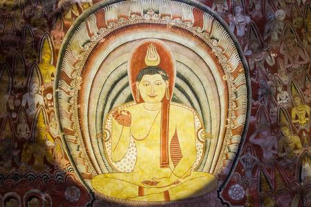 DAMBULLA, SRI LANKA - FEBRUARY 17, 2017: Mural paintings frescoes inside Dambulla Cave Temple, Sri Lanka.