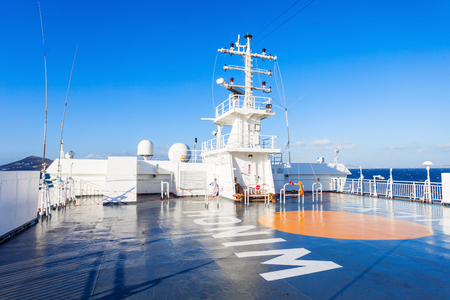 cruising: CYCLADES ISLANDS, GREECE - OCTOBER 25, 2016: Blue Star ferry open deck in the sea near Cyclades islands in Aegian sea Greece.