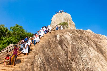 MIHINTALE, SRI LANKA - FEBRUARY 11, 2017: Unidentified pilgrims at the Mihintale Aradhana Gala or Meditation Rock at the Mihintale ancient city, Sri Lanka. Stock Photo - 87145767