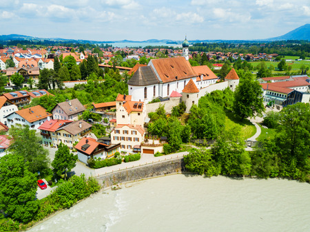 Franciscan Monastery or St. Stephan Franziskanerkloster aerial panoramic view. St. Stephan is a monastery in Fussen old town in Bavaria, Germany. Stock Photo