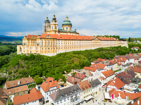 Melk Abbey Monastery aerial panoramic view. Stift Melk is a Benedictine abbey in Melk, Austria. Monastery located on a rocky outcrop overlooking the Danube river and Wachau valley.