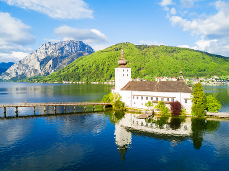 Gmunden Schloss Ort or Schloss Orth on the Traunsee lake aerial panoramic view, Austria. Gmunden Schloss Ort is an Austrian castle founded around 1080 year. Stock Photo