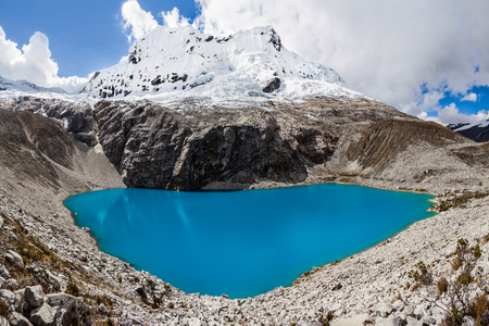 Lake Laguna 69 and Chakrarahu mountain are situated in the Huascaran National Park in the Andes of Peru.