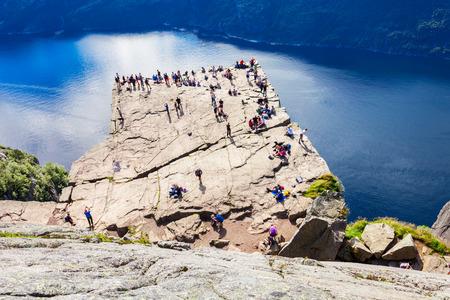Preikestolen or Prekestolen or Pulpit Rock is a famous tourist attraction near Stavanger, Norway. Preikestolen is a steep cliff which rises above the Lysefjord. Stock Photo
