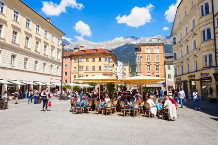 INNSBRUCK, AUSTRIA - MAY 22, 2017: Street cafe located in Altstadt Old Town of Innsbruck, Austria. Innsbruck is the capital city of Tyrol.