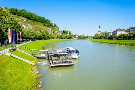 Salzach river in Salzburg, Austria. Salzach river flow eventually joins the Danube river. Stock Photo