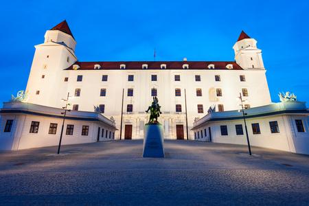 Bratislava Castle or Bratislavsky Hrad is the main castle of Bratislava, capital of Slovakia at sunset. Bratislava Castle is located on rocky  hill above the Danube river. Stock Photo
