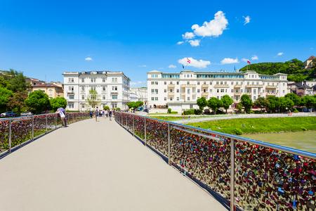 Bridge through the Salzach river in Salzburg, Austria. Salzach river flow eventually joins the Danube river.