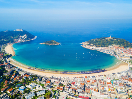 Santa Clara Island and San Sebastian Donostia city aerial panoramic view, Basque country in Spain