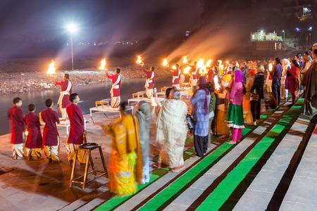 RISHIKESH, INDIA - NOVEMBER 08, 2015: Ganga Aarti ceremony in Rishikesh, India. It is a Hindu ritual of worship, in which light from wicks soaked in ghee is offered to deity.
