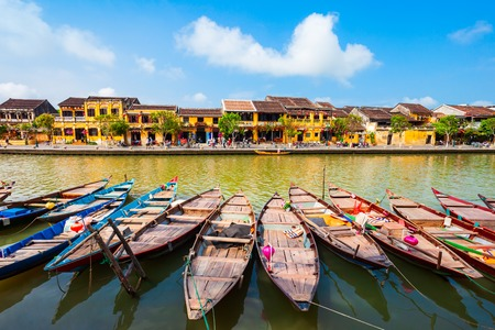 Fishing boats at the riverfront of Hoi An ancient town in Quang Nam Province of Vietnam Banco de Imagens